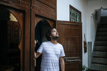 Morocco, Tanger, tourist admiring traditionally Moroccan interior architecture - KIJF01806