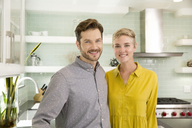 Portrait of smiling couple in kitchen - MFRF01073