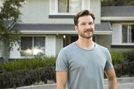 Portrait of confident man in front of his home - MFRF01130