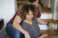 Young couple at home relaxing on stairs - HHLMF00132