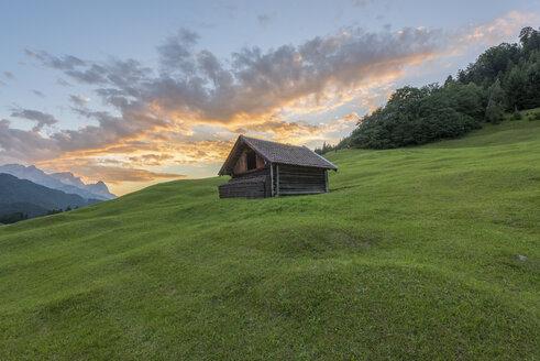 Germany, Bavaria, Werdenfelser Land, hay barn at sunrise - RPSF00077