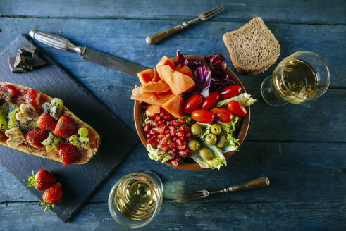 Salad with tomato, pomegranate, papaya and olives, with papaya and glass of wine - KIJF01832