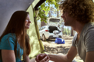 Smiling young couple in a tent - SRYF00716