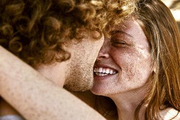 Happy young couple hugging - SRYF00725