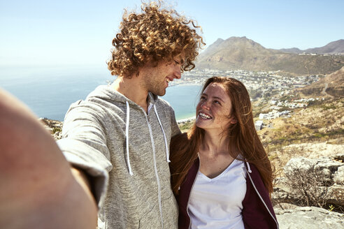 South Africa, Cape Town, happy young couple in coastal landscape - SRYF00737