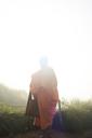Thailand, Phu Chi Fa, buddhist monk praying with orange robe - IGGF00337