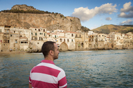 Italy, Sicily, Cefalu, Man looking at view - EPF00480