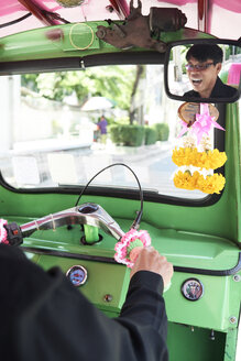 Thailand, Bangkok, driver having fun in his tuk-tuk taxi - IGGF00344