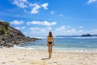 Indonesia, Lombok, woman on sandy beach - KNTF00947