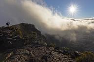 Reunion, Reunion National Park, Shield Volcano Piton de la Fournaise, Photographer at Pas de Bellecombe against the sun - FOF09616