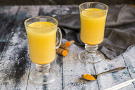 Two glasses of curcuma milk - SARF03458