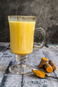 Glass of curcuma milk - SARF03461