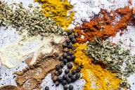 Spices, curry, chilli, cinnamon, curcuma, garlic, parsley, oregano, salt and pepper on wood - SARF03467