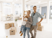 Portrait of happy family moving into new home - KNSF03393
