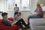 Group of students in dormitory learning together - ZEDF01086