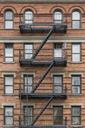 USA, New York City, Manhattan, building with fire escape - RPSF00122