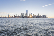 USA, New York City, Manhattan, New Jersey, cityscape at sunset - RPSF00128