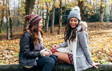 Two pretty women having fun in an autumnal forest - MGOF03694