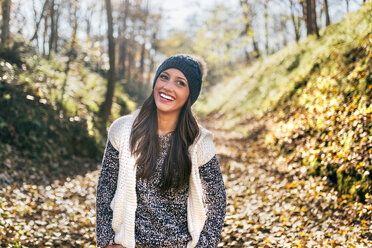 Portrait of a beautiful happy woman in an autumnal forest - MGOF03709