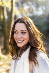 Portrait of a beautiful smiling woman in an autumnal forest - MGOF03733