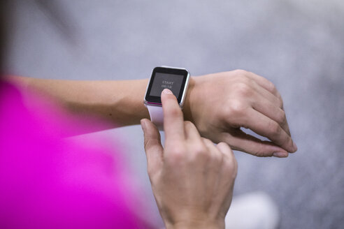 Close up of female hands checking smartwatch - SBOF00984