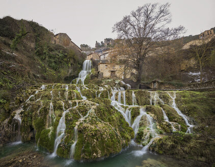 Spain, Burgos, Waterfall in village Orbaneja del Castillo - DHCF00170