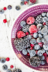Bowl of deep frozen red currents, rapsberries and blackberries - LVF06596