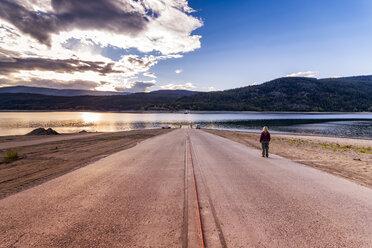 Canada, British Columbia, Arrow Lake, woman waiting at mooring area - SMAF00910