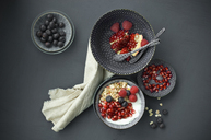 Muesli with pomegranate seeds and different berries in bowl - ASF06147