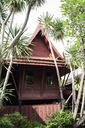 Thailand, Bangkok, Thai-style red house surrounded by nature - IGGF00373