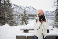 Young woman in alpine winter landscape with lake - SUF00407