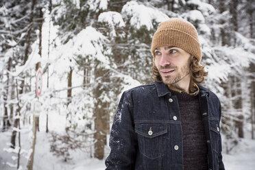 Portrait of man in winter forest - SUF00431