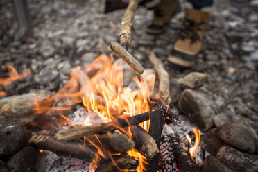 Sausage over camp fire - SUF00458