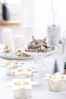 Poppy seed cookies on glass cake stand at Christmas time - SBDF03442
