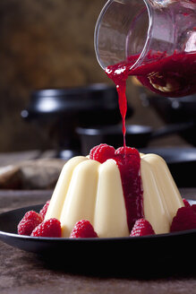 Custard with raspberries and raspberry sauce on plate - CSF28730