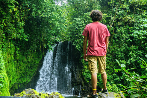 Costa Rica, Man looking at a waterfall onn the Cerro Chato route - KIJF01847