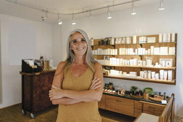 Portrait of smiling businesswoman in her shop - KNSF03515