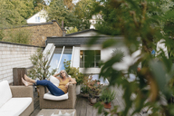 Woman relaxing on terrace - KNSF03527