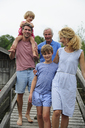 Happy family walking together on boardwalk in summer - ECPF00174