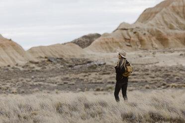 Woman standing in barren landscape - JPF00301