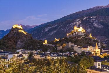 Switzerland, Canton Vaud, Sion, townscape with Tourbillon Castle, Notre-Dame de Valere and Notre Dame du Glarier at dusk - WDF04311
