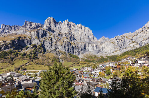 Switzerland, Valais, Leukerbad, townscape with mountain massif - WDF04314