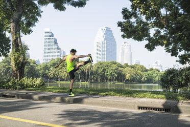 Runner warming up in urban park - SBOF01138