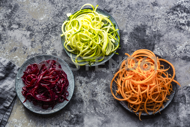 Bowl of Zoodles and bowls of carrot  and beetroot spaghetti - SARF03468