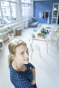 Portrait of smiling woman in a loft - JOSF02134