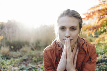 Portrait of young woman in autumnal park - JOSF02149