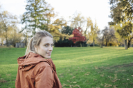 Portrait of young woman in autumnal park - JOSF02155
