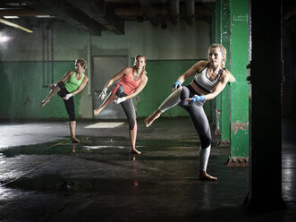 Three women having a workout in a hall - CVF00009