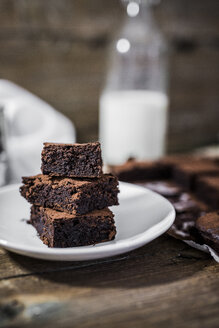 Stack of three homemade brownies on plate - GIOF03753