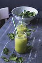 Two glasses of spinach smoothie with hemp seed - ODF01580